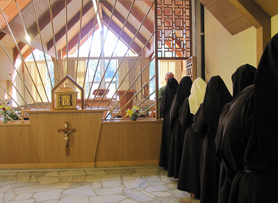 Image of Carmelite Nuns receiving Jesus in Holy Communion